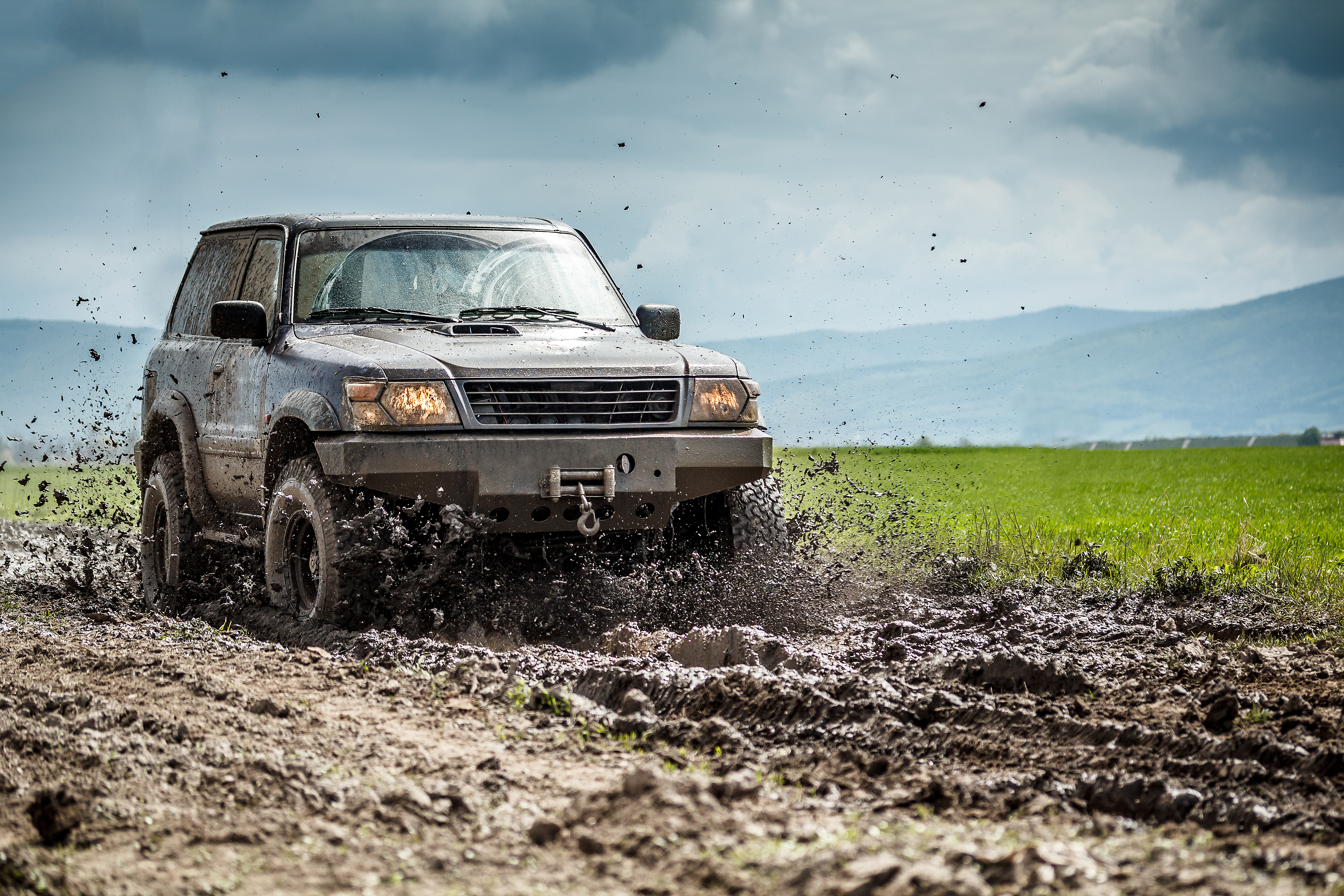 "Featured image for ""Why Use Synthetic Oil Over Conventional?"" blog post. Off road SUV."